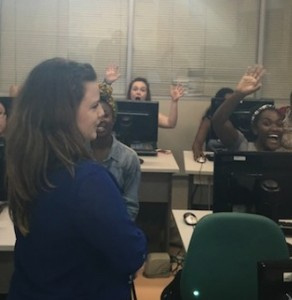 Carol teaches the class about publicly available datasets, while students wave to the paparazzi.