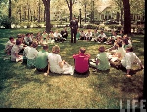 """Ervin, Christopher. """"Students sitting in circle listening to teacher outside on campus of New Trier High School."""" Photograph. Teaching Portfolio. WordPress, June 1950. Web. 27 Apr. 2016."""
