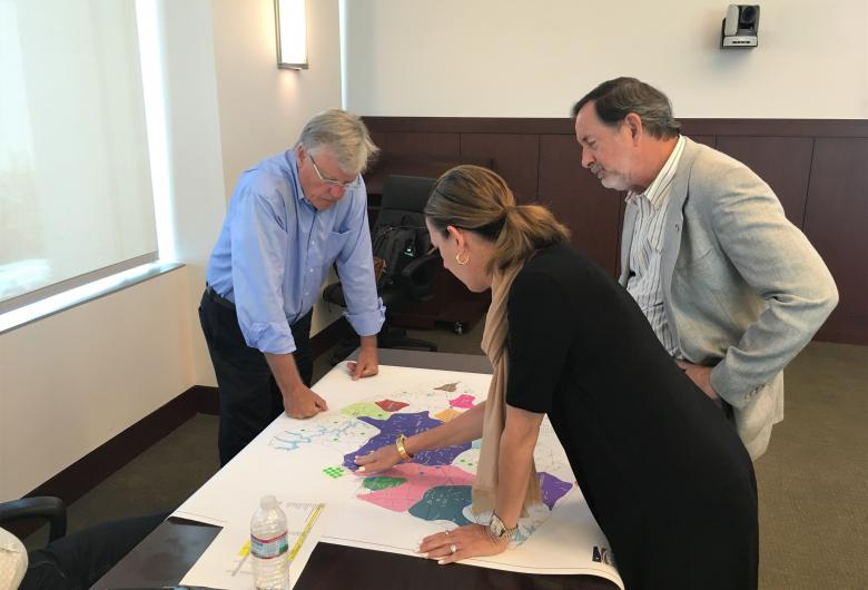 Planning Board members interact with planning maps