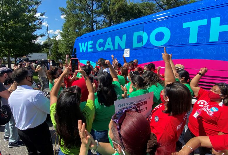 Crowd cheers outside 'We Can Do This' bus at presidential visit