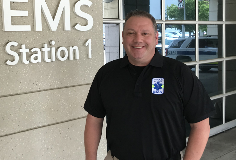 Chief Wenzel in front of EMS station 1.