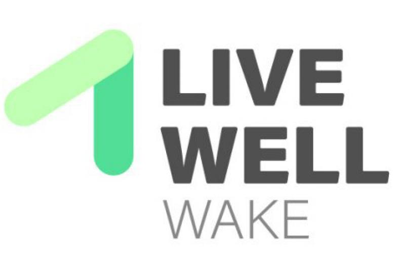 Live Well Wake logo, with green arrow pointing up and to the the right