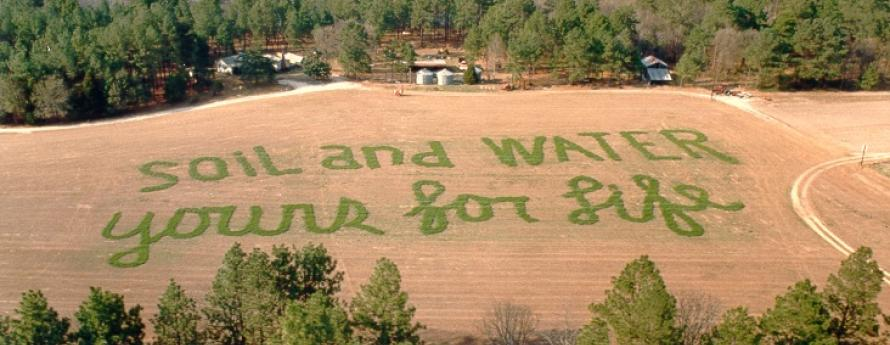 Soil and Water For Life spelled out in agricultural field