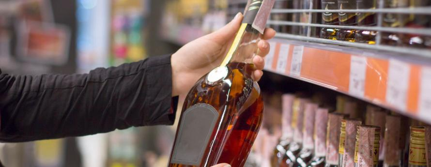 Person holding bottle of alcohol