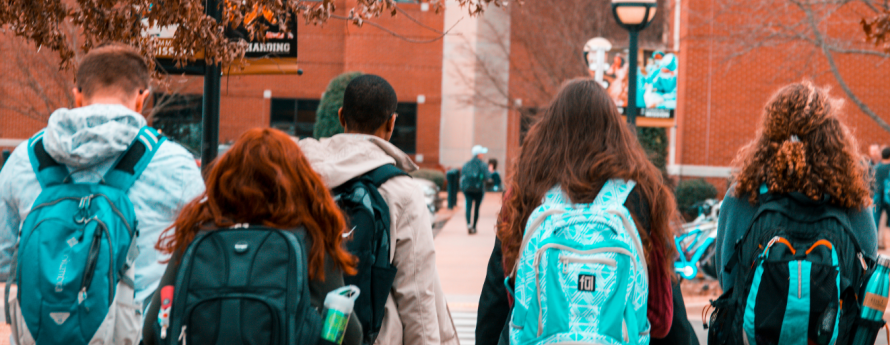 Group of young adults walking into class