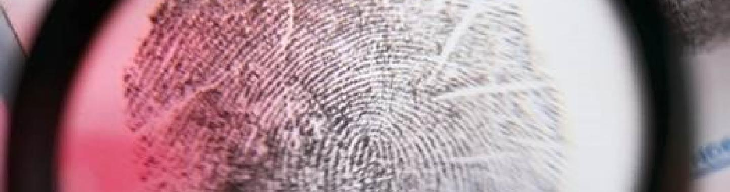 Fingerprint card enhanced with magnifying glass