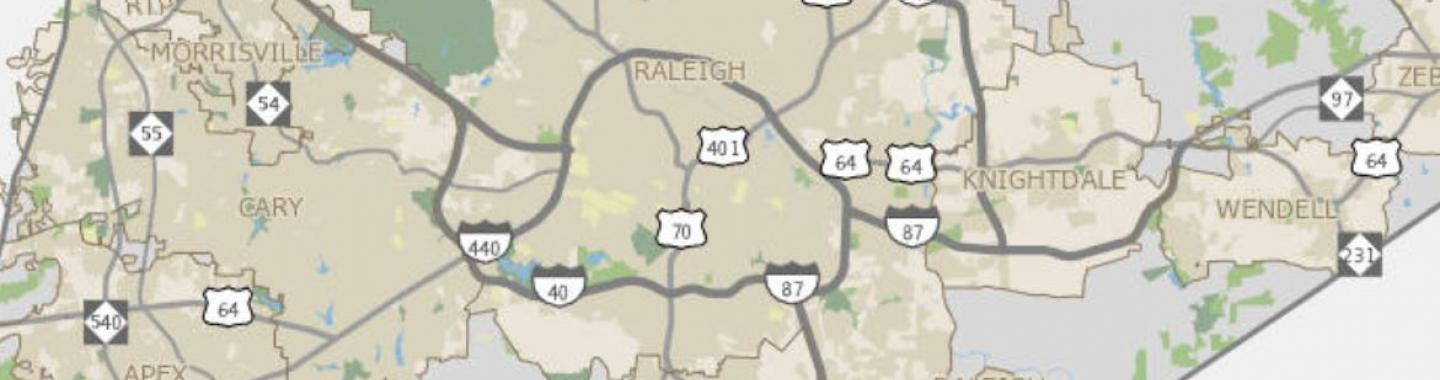 Snip of a map of Wake County showing major roads, towns & cities, and parks