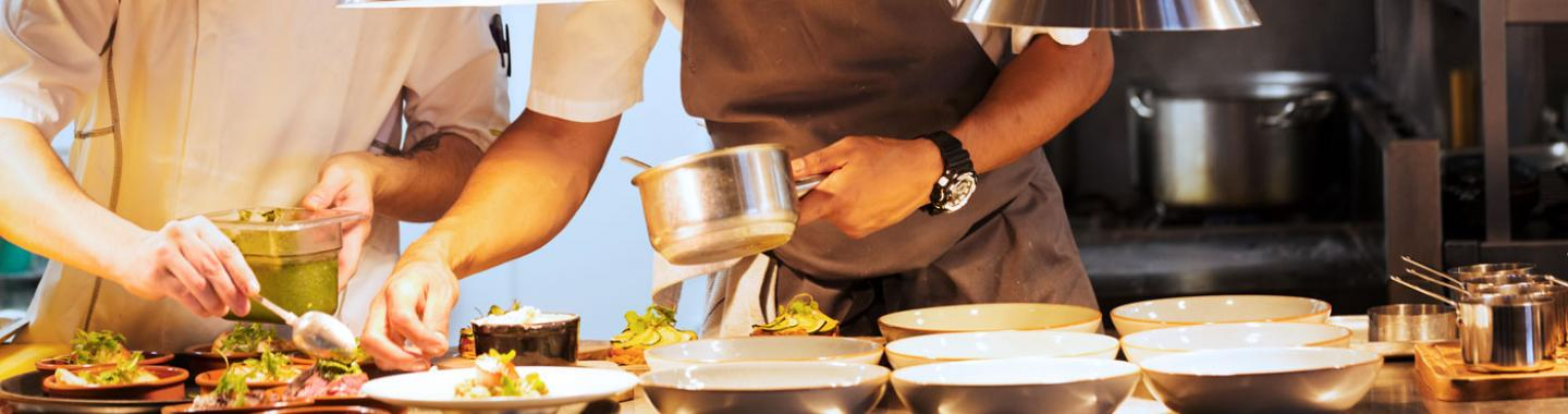 Chefs preparing food at a restaurant