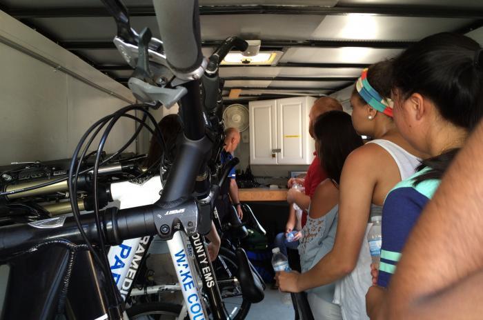 EMS camp participants looking at paramedic bicycles