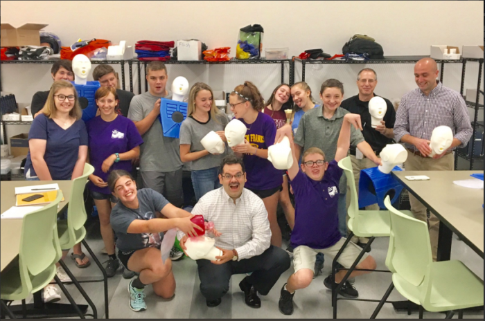 EMS club participants posing with manikins