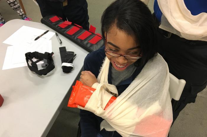 EMS club participant with arm splint