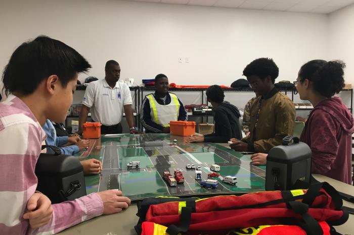 EMS club participants training for mass casualty incidents with a table top exercise