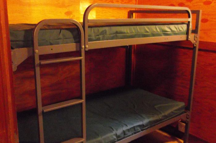 image of a very small room with a single bunkbed used by chaperones of  groups at the Blue Jay Overnight Lodge