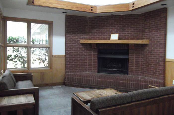 Image of sofas gathered around the fireplace at the Blue Jay Overnight Lodge