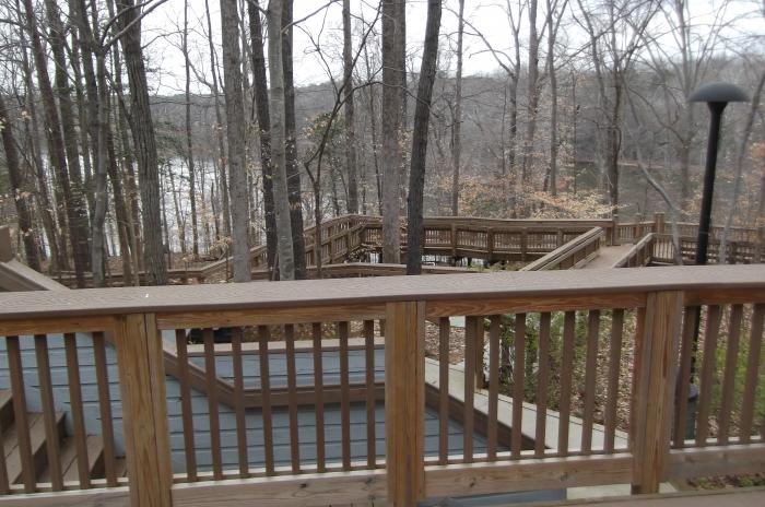 View of Falls Lake from the outside deck railing at the Blue Jay Overnight Lodge