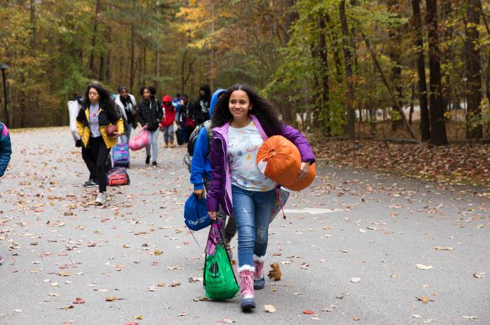 5th grade students with overnight gear arriving to stay at Blue Jay's Overnight Lodge