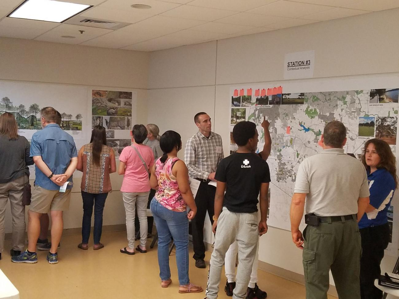 staff and public discuss projects in public meeting