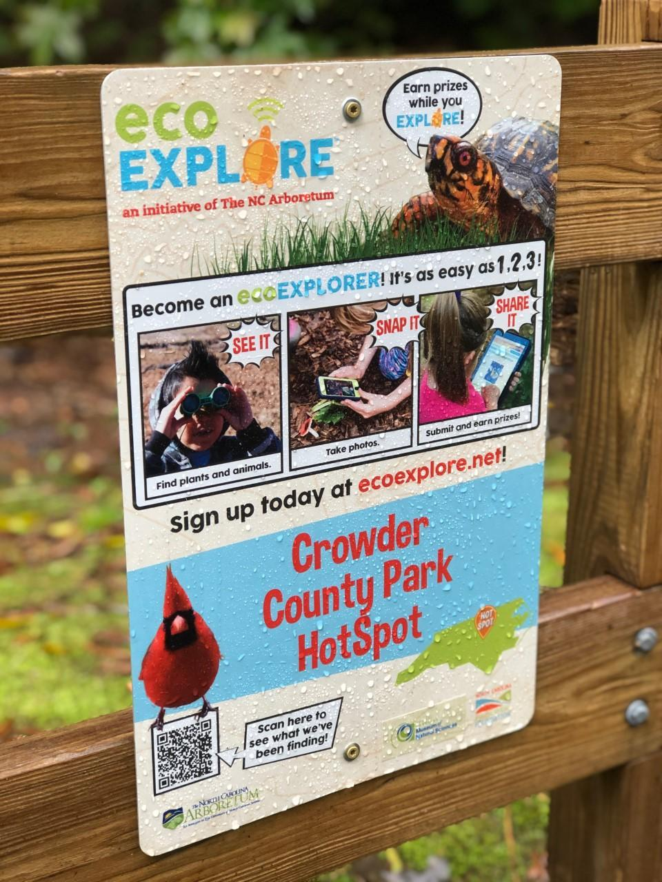 image of eco-explore sign on wooden fence posts