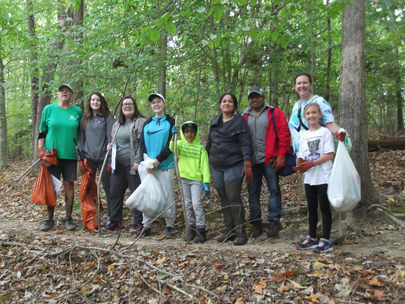 Group of volunteers after working to remove litter from the park