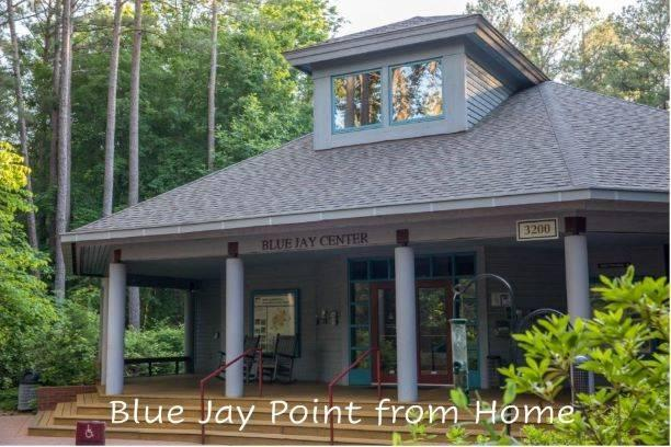 """View of the front of the Blue Jay Center for Environmental Education with the words """"Blue Jay Point from Home"""" superimposed at the bottom."""
