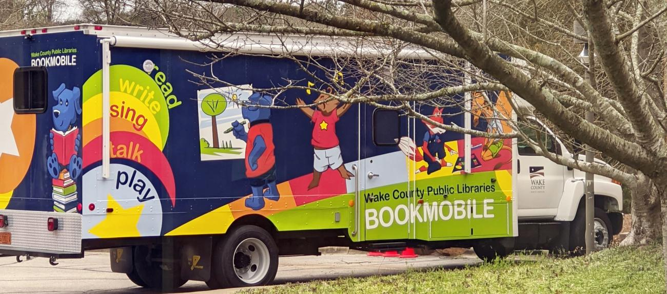 WCPL Bookmobile among the trees on a cloudy day