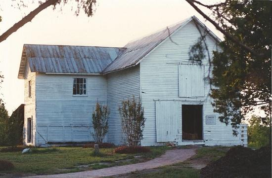 View of the Cotton Gin House before restoration in the 1990s