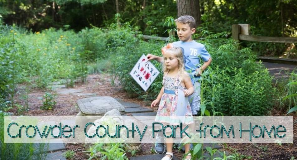 Two children wander through the flower garden with their nature scavenger hunts