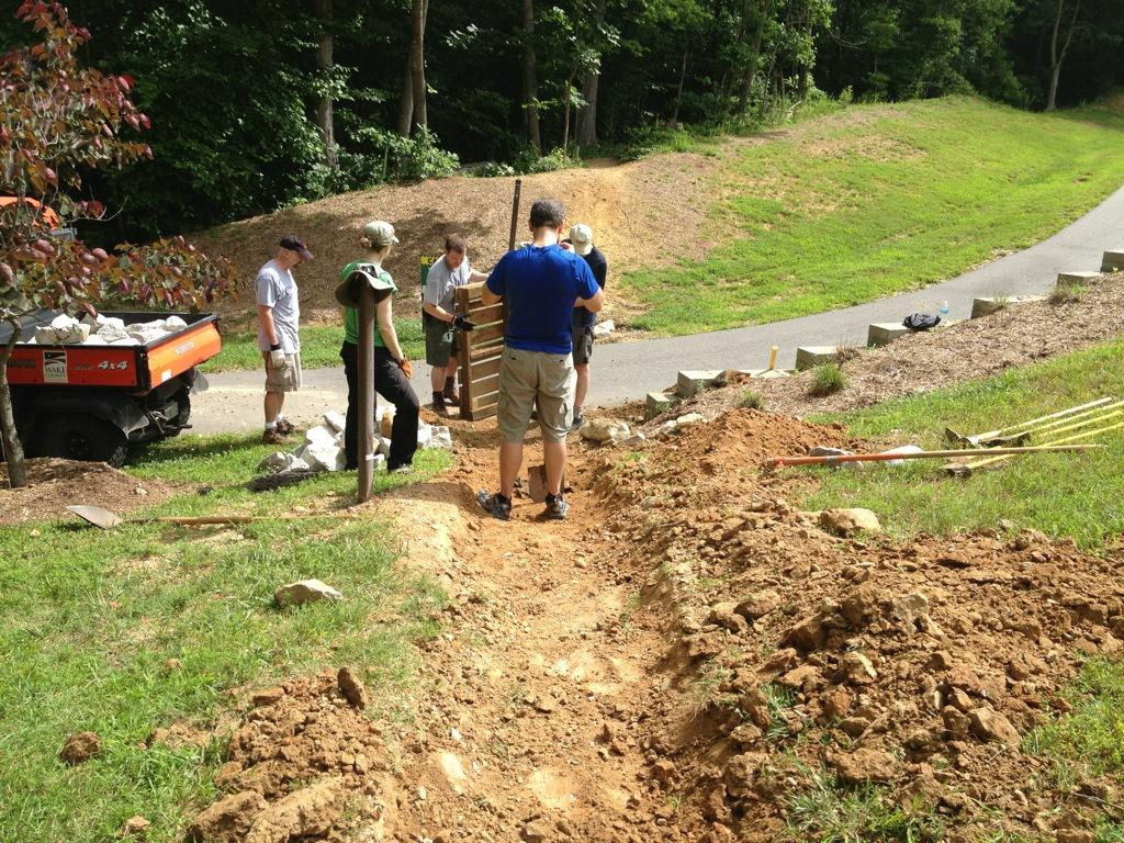 TORC volunteers and park staff repairing section of mountain biking trail.