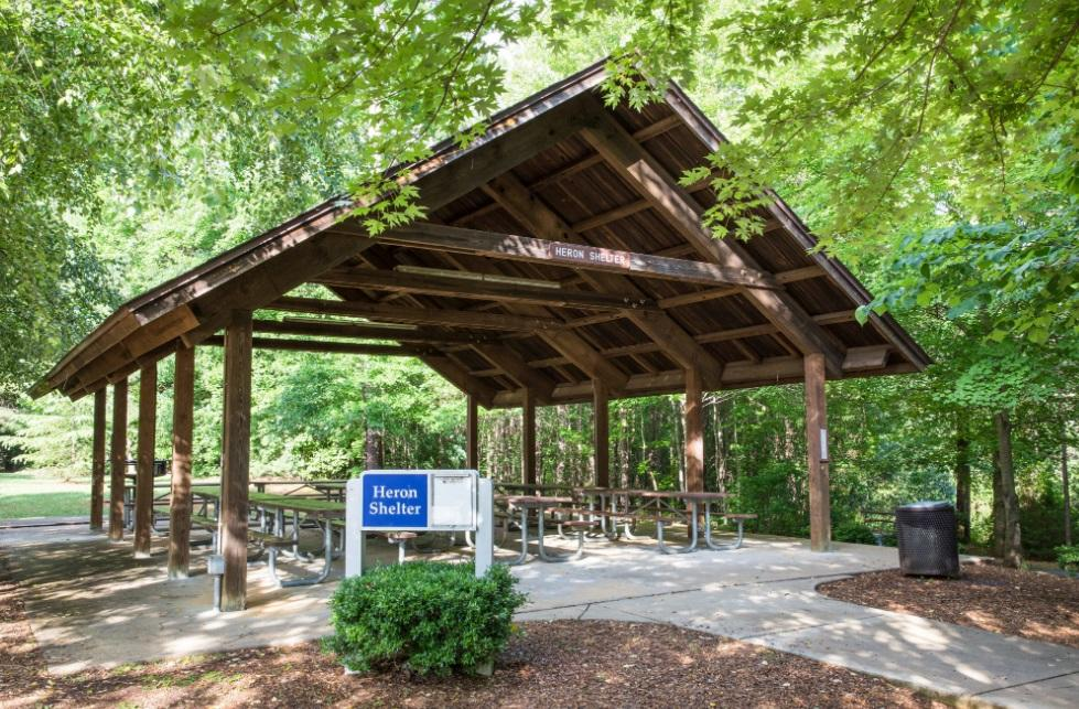 View of parks largest sized wooden picnic shelter with picnic tables