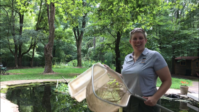 Instructor holding dipnets and pick pans at the Blue Jay Study Pond