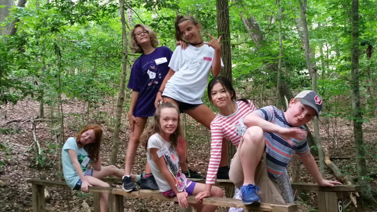 Older elementary aged campers striking a funny pose for the camera