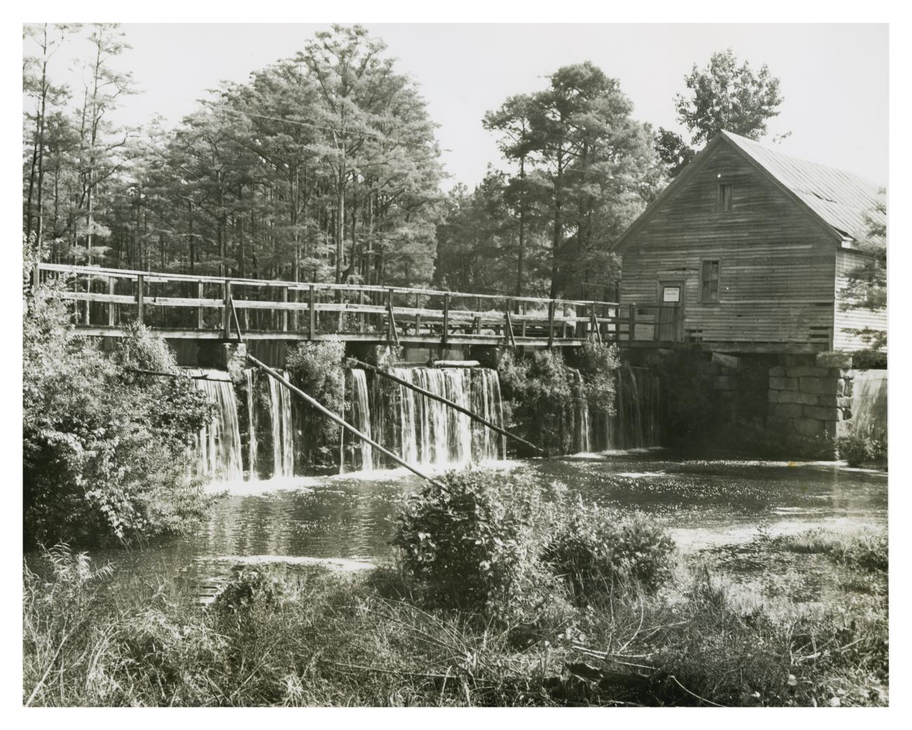 Historical photo of the mill and dam