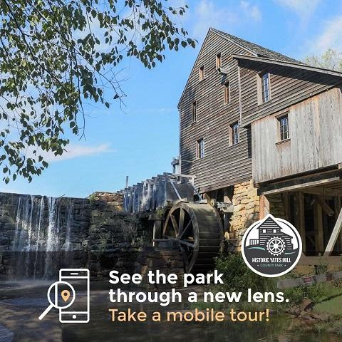 mobile tour advertisement with mill building in background