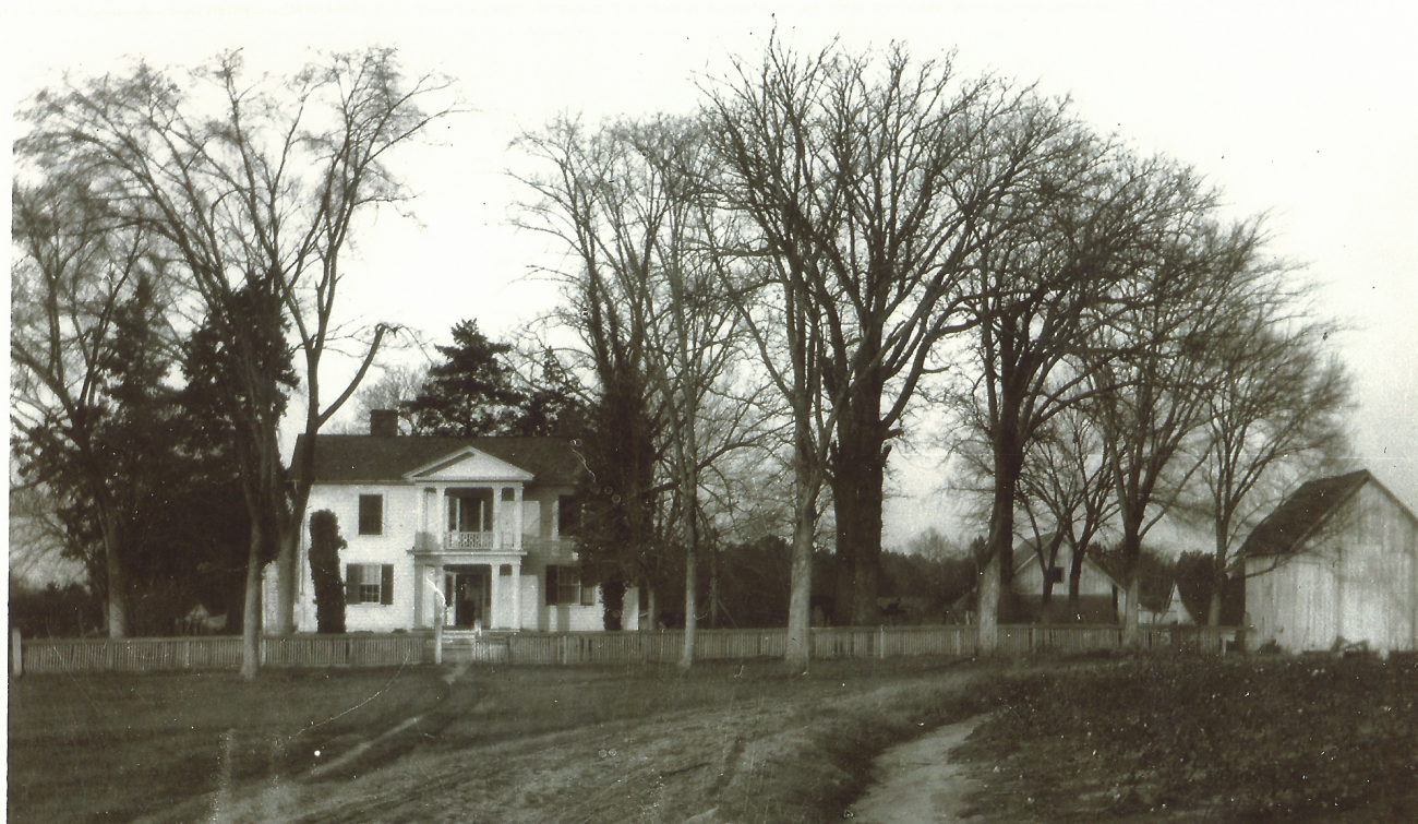 Historic black and white image of the Oak View farmhouse from the early 1900s