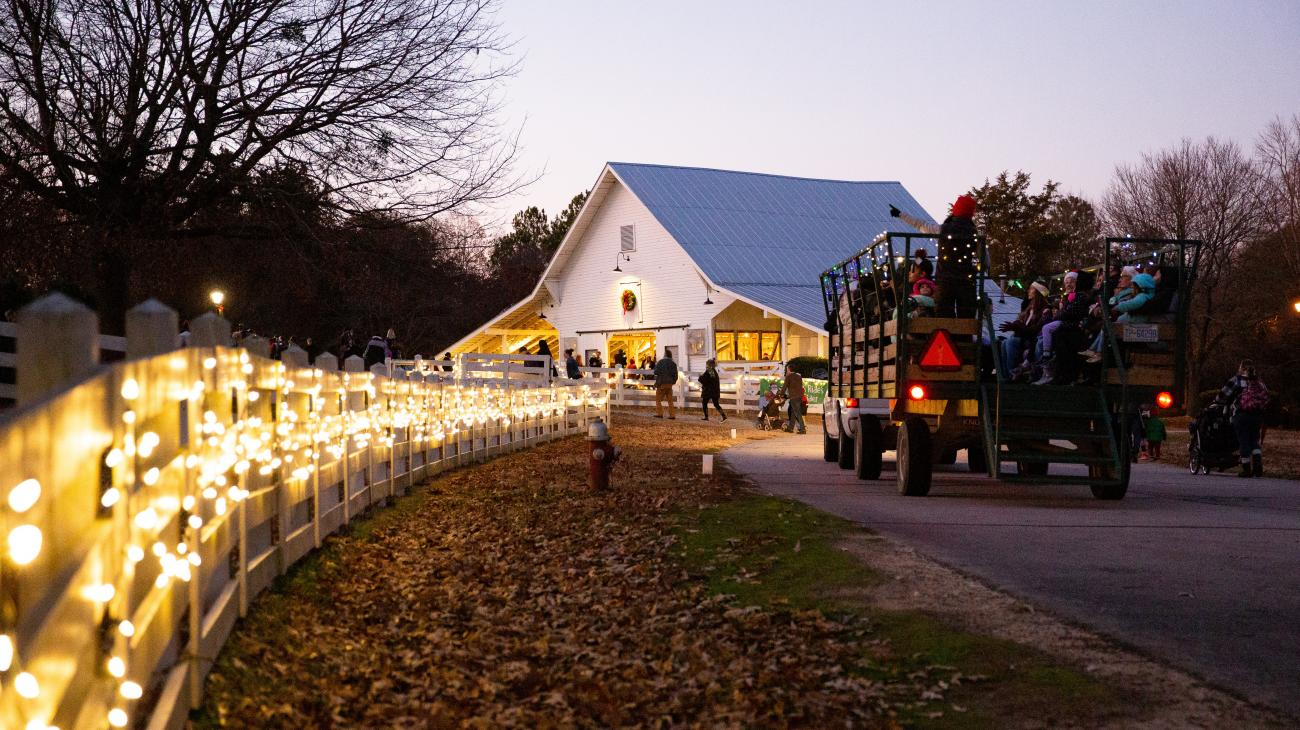 Night shot of the Livestock Barn during Sleigh Rides event with holiday lights