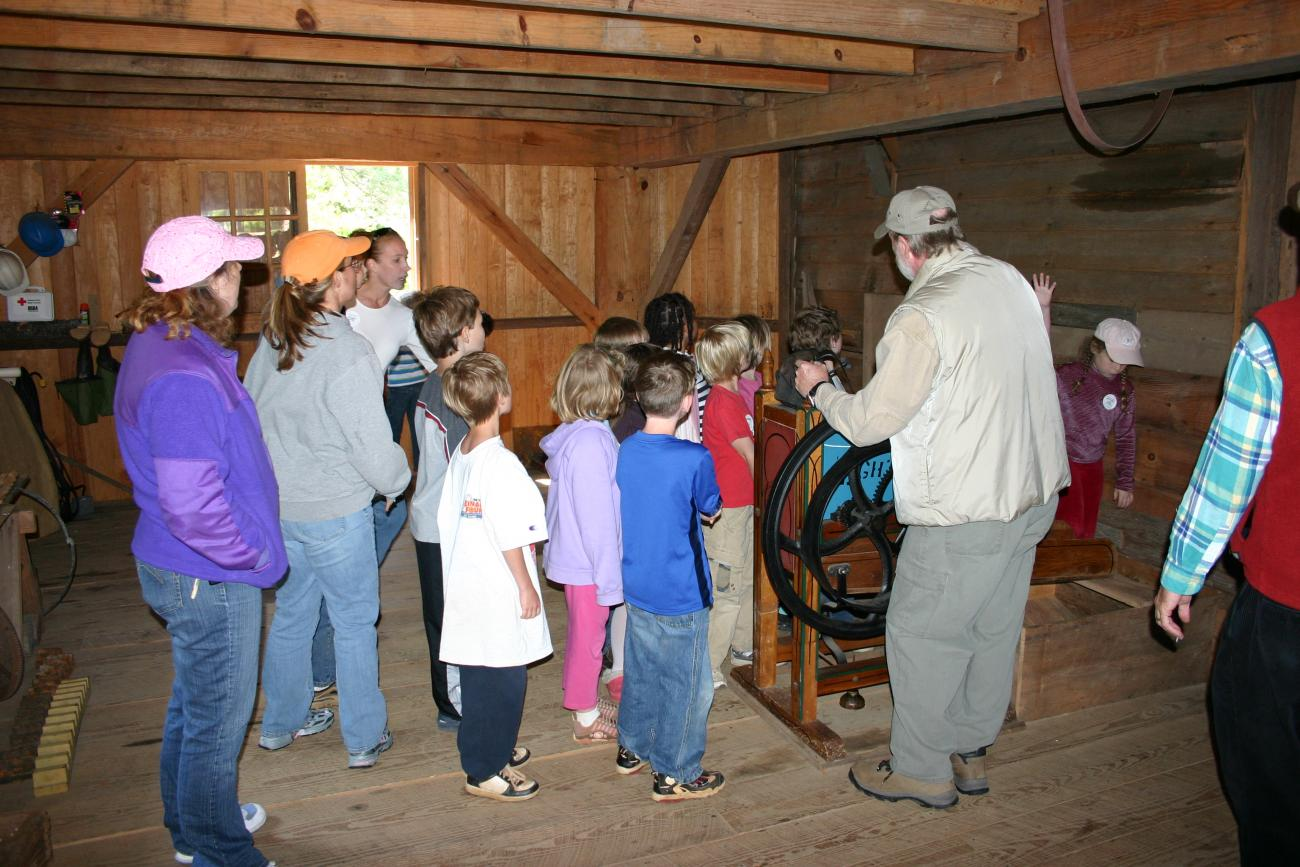 tour group stands inside of old historic mill building