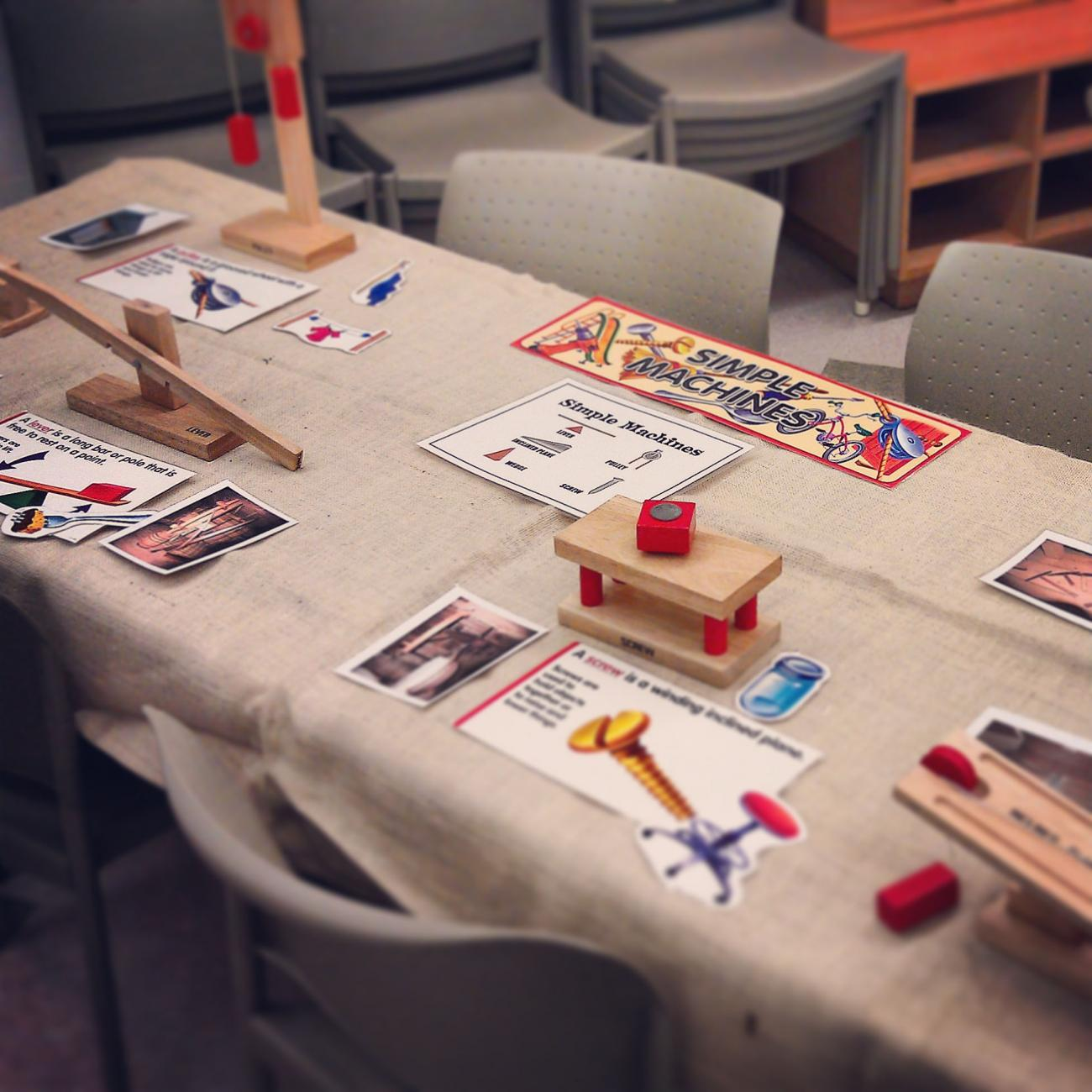 wooden simple machines models (pulley, lever, wheel) on table
