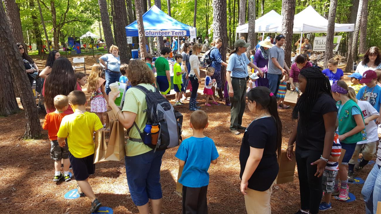 Festival participants visiting booths and activities at Songbird Celebration