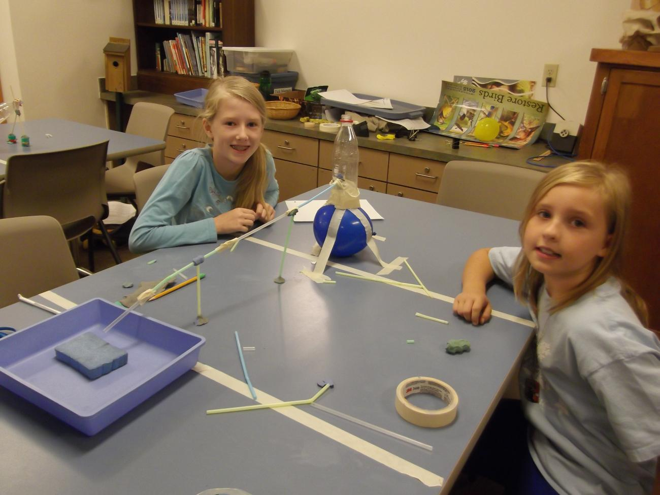 Girls in camp showing off their irrigation engineering project