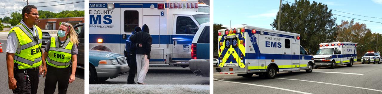 Paramedics talking in front of ambulances