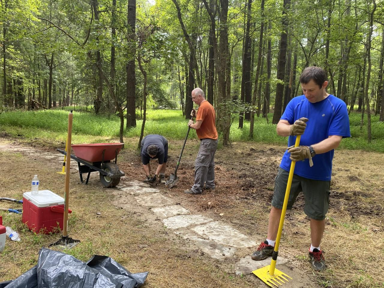 Photo of volunteers from Triangle Off Road Cyclists working on a section of the mountain bike trail