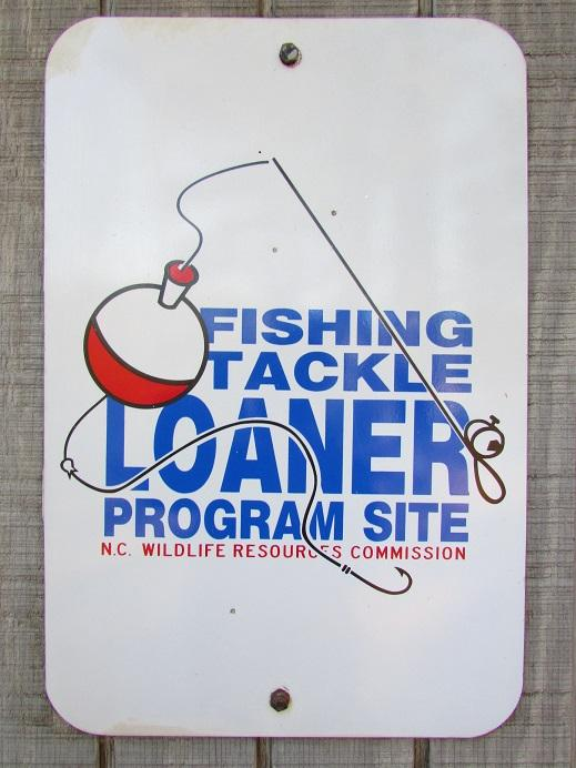 Photo of the Tackle Loaner metal sign on the shed which contains the park's fishing supplies