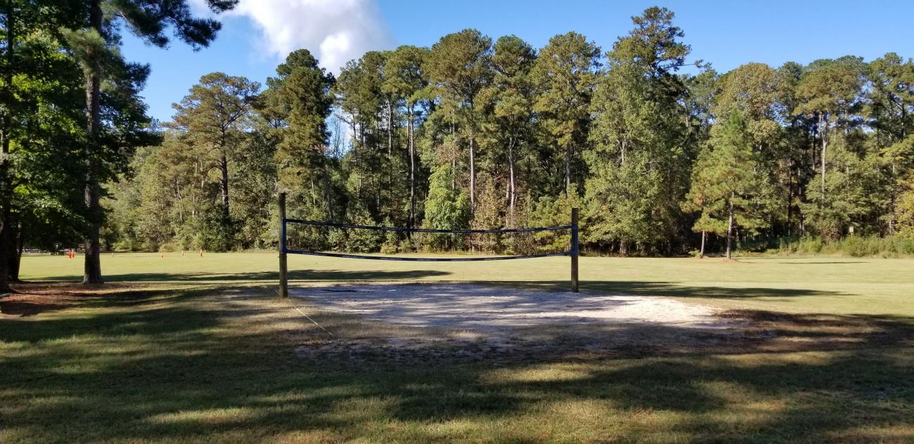 View of the sand volleyball court and open play field