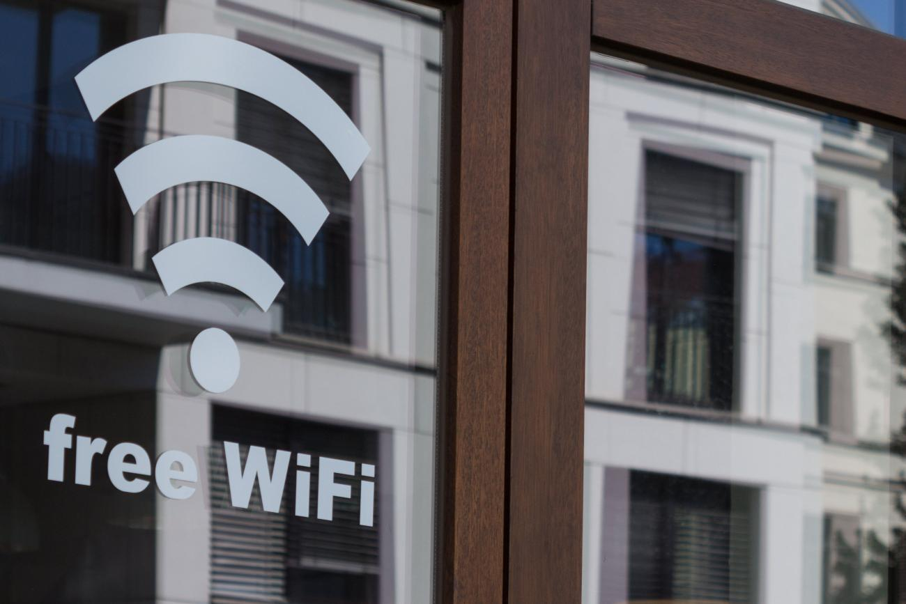 an office building in the background with a Wi-Fi symbol overlayed onto it