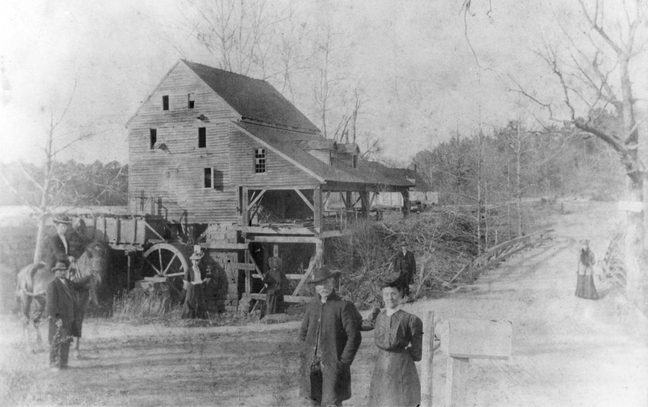 old black and white photo of historic mill from 1890
