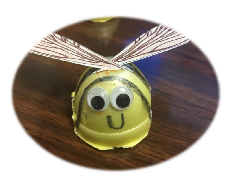 yellow egg carton bee craft with paper wings and googly eyes