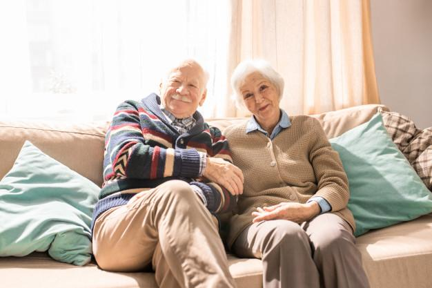 Elderly couple relaxing on a sofa.