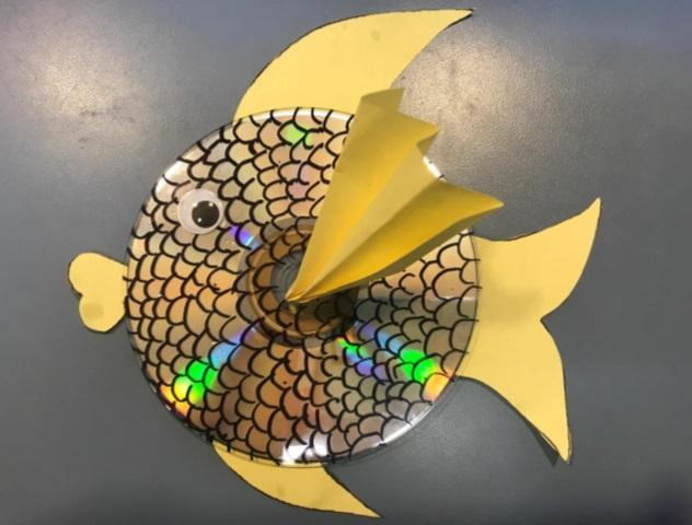 compact disc with googly eyes and fins to look like fish