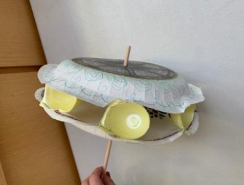 paper plate craft designed to look like waterwheel with egg cartons