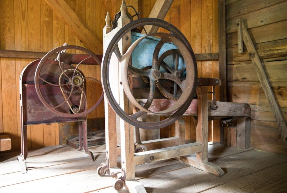 old mill equipment inside of old wooden mill building